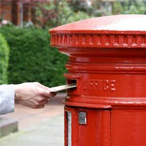 View of someone posting a package into a letter box