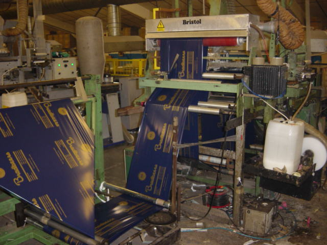 view of a poly bag production machine being fed polythene